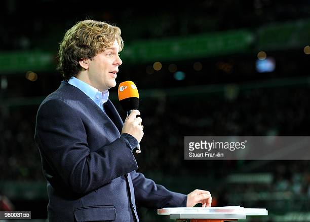 ZDF television reporter Michael Steinbrecher during the DFB semi final match between SV Werder Bremen and FC Augsburg at Weser Stadium on March 23...