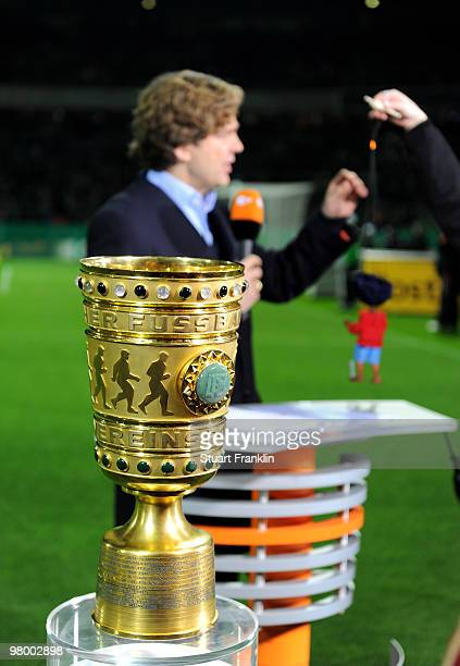 ZDF television reporter Michael Steinbrecher with a Jim Knopf puppet during the DFB semi final match between SV Werder Bremen and FC Augsburg at...