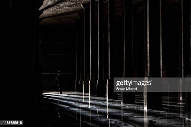 A television reporter practices his lines before a piece to camera inside the soon to be repurposed World War II oil tank at the Art Gallery of New...