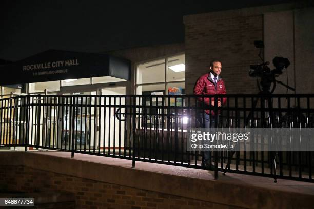 A television reporter stands outside the Rockville City Hall during a hearing on a propsal to become a 'sanctuary city' at City Hall March 6 2017 in...