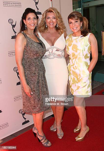 Television reporters Christine Devine Wendy Burch and Ana Garcia attend The Academy Of Television Arts Sciences 64th Los Angeles Area Emmy Awards at...