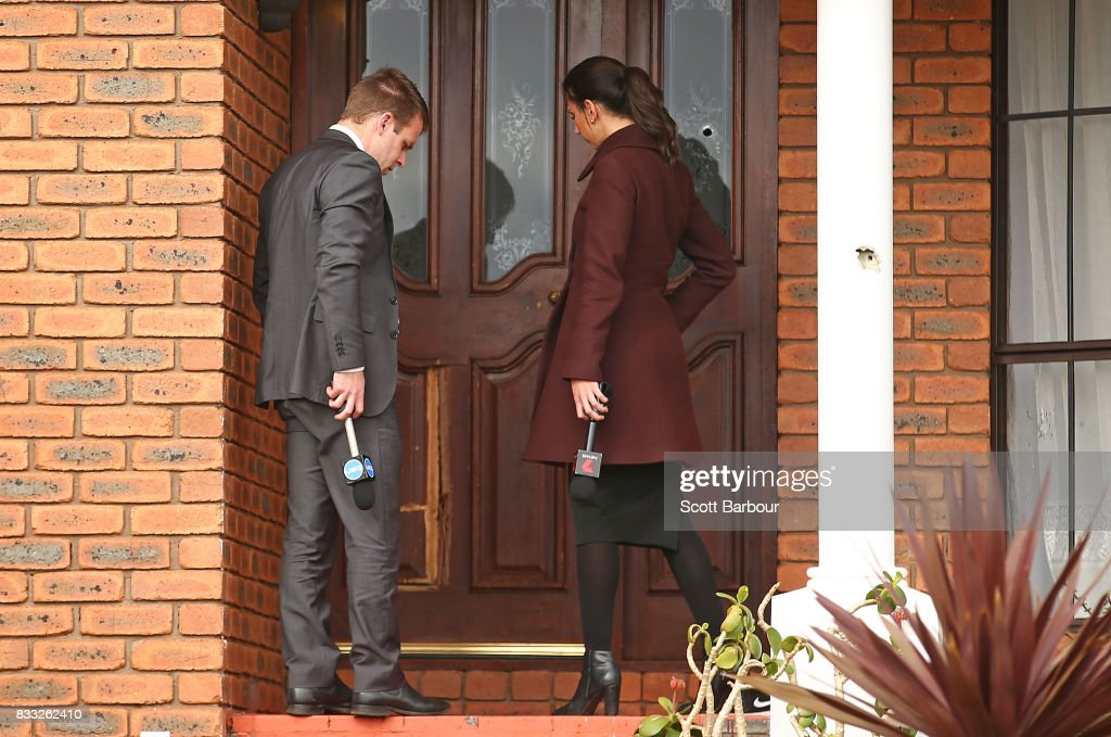 Television reporters knock on the front door next to bullet holes in the windows after a drive-by shooting at a property in Narre Warren in Melbourne's south eastern suburbs on August 17, 2017 in Melbourne, Australia. Homicide detectives are investigating the death of a 26-year-old man who was killed at the Kurrajong Road house as a result of the shooting.