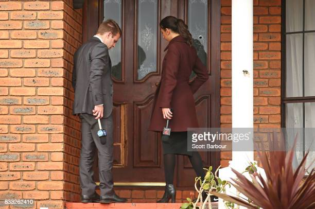 Television reporters knock on the front door next to bullet holes in the windows after a driveby shooting at a property in Narre Warren in...