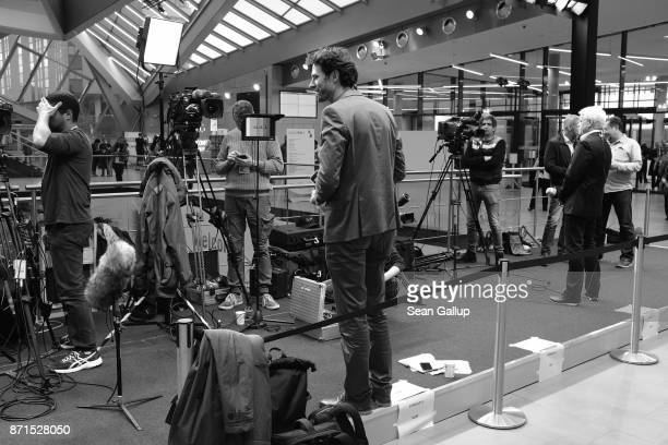 Television reporters occupy their stand-up positions near the main plenary hall at the COP 23 United Nations Climate Change Conference on November 6,...