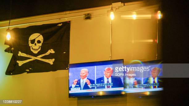 Television screen at the Sinkhole Craft Beer Bar showing the United States Republican President Donald J. Trump and Democratic opponent former Vice...