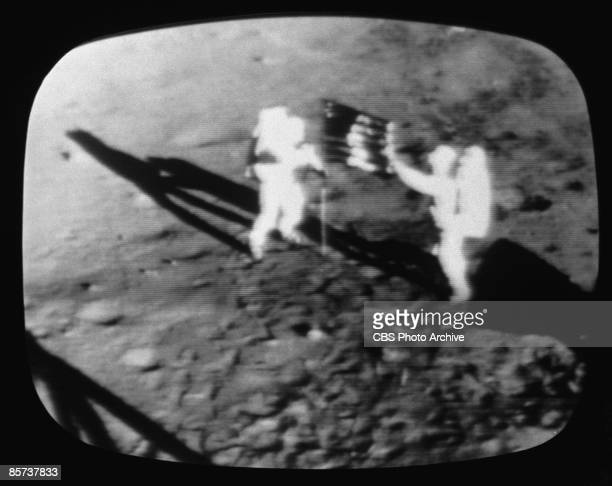 A television screen grab from a CBS News Special Report shows the Apollo 11 astronauts on the moon July 1969