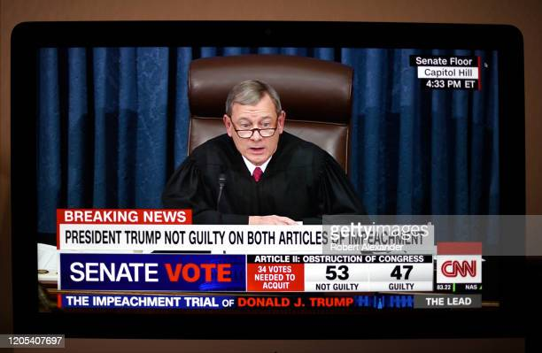 Television screen shot during live CNN coverage of the President Donald Trump impeachment trial on February 5 shows U.S. Chief Justice John Roberts...
