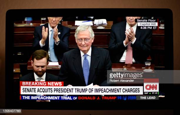 Television screen shot during live CNN coverage of the President Donald Trump impeachment trial on February 5 shows U.S. Senate Majority Leader Mitch...