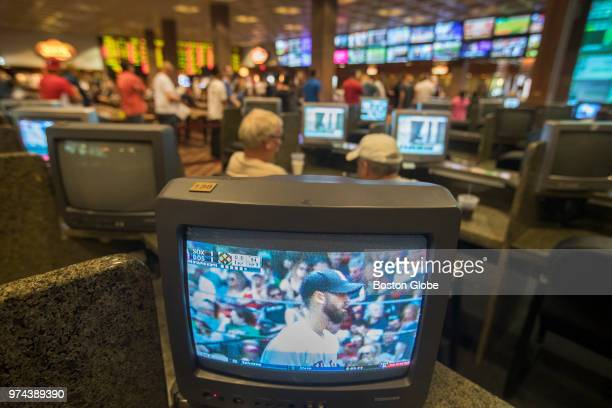 A television screen shows a baseball game between the Boston Red Sox and Chicago White Sox at Fenway Park inside Vegas Sports Betting at Delaware...