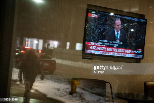 A television screen shows House impeachment manager Rep Adam Schiff during the Senate impeachment trial of US President Donald Trump at a hotel on...