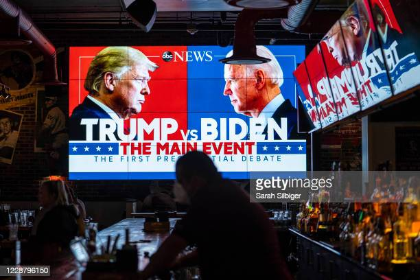 Television screens airing the first presidential debate are seen at Walters Sports Bar on September 29 2020 in Washington United States Americans...