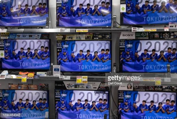 Television screens in an electronics shop display the Tokyo Olympics South Korea v Japan baseball semifinal match on August 4, 2021 in Tokyo, Japan....