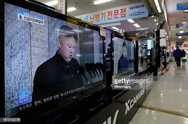 Television screens show images of Kim Jong Un leader of North Korea as they show a news broadcast on North Korea's nuclear test at an electronics...