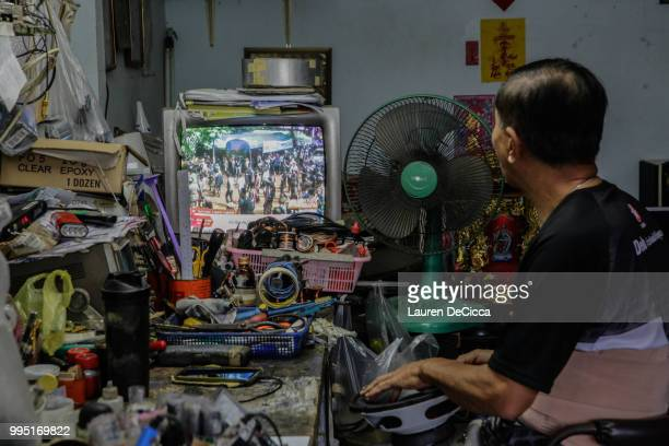 A television set broadcasting rescue efforts at a local shop near hospital Chiangrai Prachanukroh Hospital on July 10 2018 in Chiang Rai Thailand...