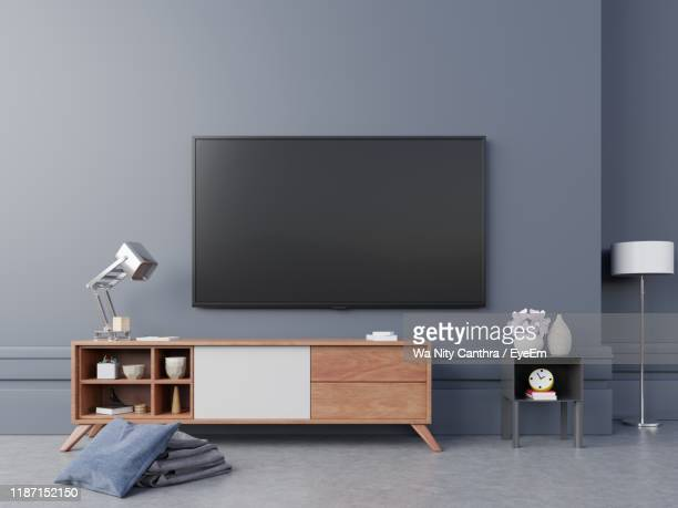 television set on wall at home - flat screen stock pictures, royalty-free photos & images