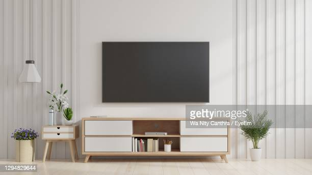 television set on wall at home - television stock pictures, royalty-free photos & images