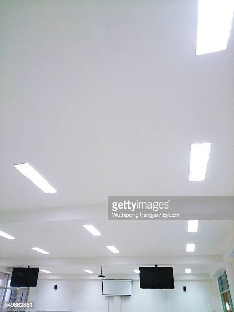 television set with projector in boardroom - ceiling stock pictures, royalty-free photos & images