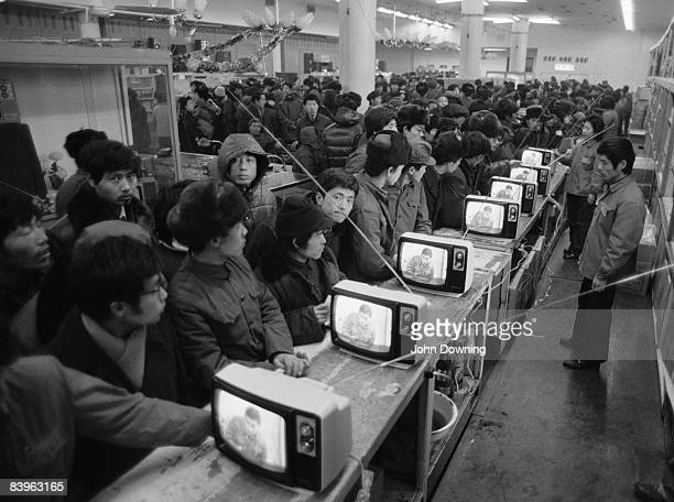 Television sets on display at a busy department store China February 1985