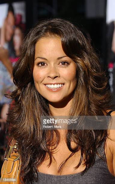 "Television show host Brooke Burke attends the premiere of ""Serving Sara"" at the Samuel Goldwyn Theater on August 20, 2002 in Beverly Hills,..."