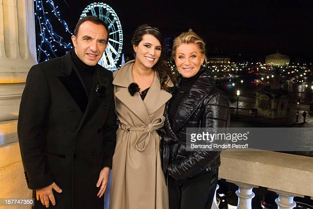 Television show hosts Nikos Aliagas and Karine Ferri and singer Sheila attend the shooting of the year end program 'Toute la musique qu'on aime ' set...