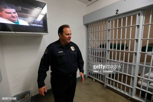 A television show is displayed on a flat screen TV as Sgt Steven Bowles gives a tour of a jail cell dorm where paytostay program inmates can watch...