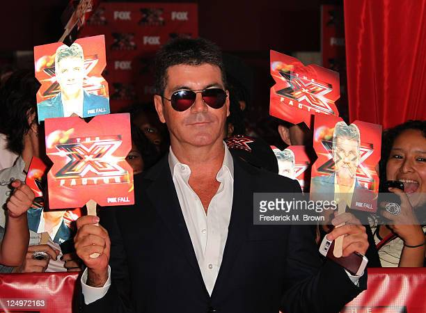 Television show judge poducer Simon Cowell arrives at the premiere Of Fox's 'The X Factor' held at ArcLight Cinemas Cinerama Dome on September 14...