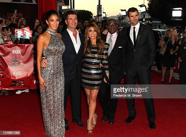 Television show judges Nicole Scherzinger Simon Cowell Paula Abdul LA Reid and show host Steve Jones arrive at the premiere Of Fox's The X Factor...