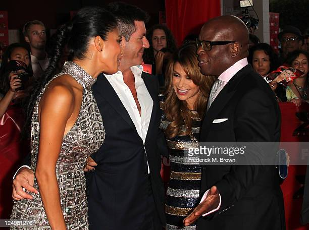Television show judges Nicole Scherzinger Simon Cowell Paula Abdul and LA Reid arrive at the premiere Of Fox's The X Factor held at ArcLight Cinemas...