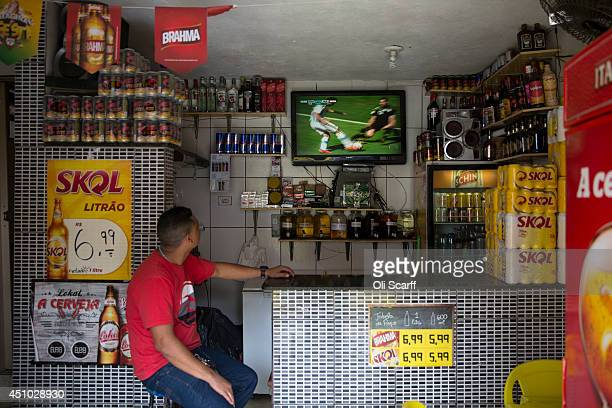 A television shows a World Cup match in a bar in the poor neighbourhood of Itaquera adjacent to the 'Arena de Sao Paulo' stadium on June 21 2014 in...