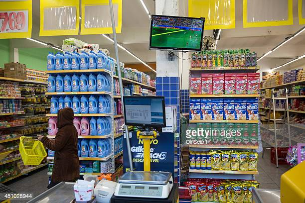 A television shows a World Cup match in a supermarket in the poor neighbourhood of Itaquera adjacent to the 'Arena de Sao Paulo' stadium on June 21...