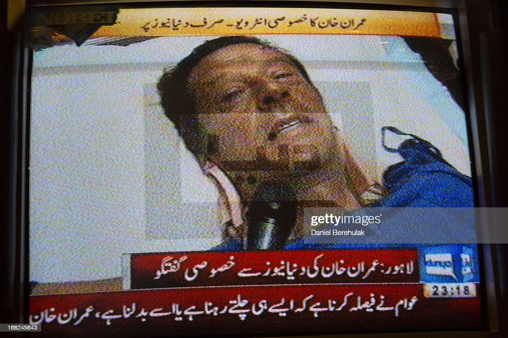 A television shows an image of Imran Khan, chairman of the Pakistan Tehrik e Insaf (PTI) party, giving an interview with a local television network as he lays in critical but stable condition after being injured from falling off a lifter during an election campaign rally on May 07, 2013 in Lahore, Pakistan. PTI chairman Imran Khan was injured at a rally in Lahore today after having fallen from a lifter. Pakistan's parliamentary elections are due to be held on May 11. Imran Khan of Pakistan Tehrik e Insaf (PTI) and Nawaz Sharif of the Pakistan Muslim League-N (PMLN) have been campaigning hard in the last weeks before polling.