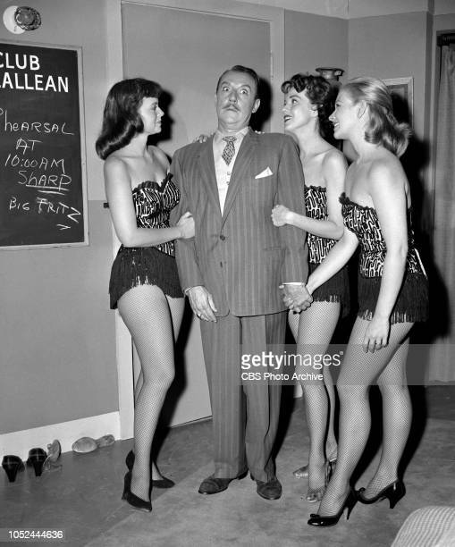 CBS television situation comedy The Box Brothers Back stage Gale Gordon surrounded by chorus girls Image dated October 9 1956 Los Angeles CA