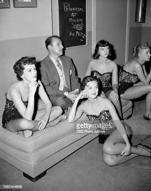 CBS television situation comedy The Box Brothers Back stage Gale Gordon surrounded by chorus girls Left to right they are Aline Towne Marilee Earle...
