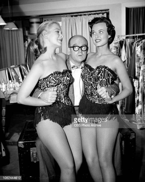 CBS television situation comedy The Box Brothers Pictured is Bob Sweeney is flanked by two chorus girls Image dated October 9 1956 Los Angeles CA