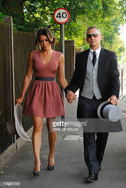 Television sports commentator and former England football player Gary Lineker walks with his wife Danielle Bux on the first day of the annual Royal...