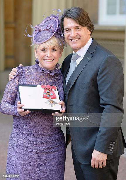Television star Barbara Windsor with husband Scott Mitchell after she was made a Dame Commander of the order of the British Empire by Queen Elizabeth...
