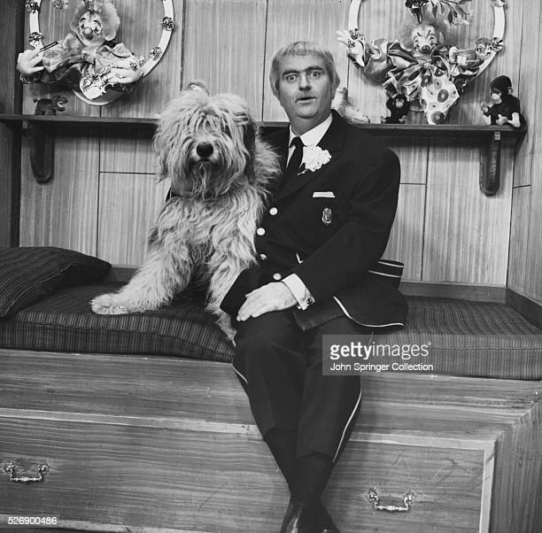 Television still featuring Captain Kangaroo with a dog on the popular kid's television show 'Captain Kangaroo'