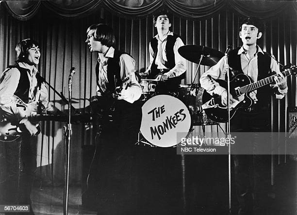 Television still shows the popular music and television group the Monkees as they perform onstage in an episode of their selftitled tv show late...