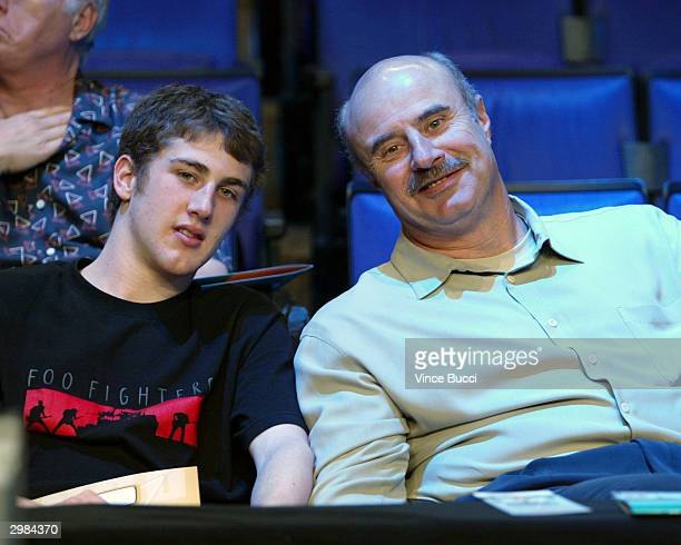 Television talk show host Dr Phil McGraw and son Jordan attend the NBA AllStar Saturday Night festivities on February 14 2004 at the Staples Center...