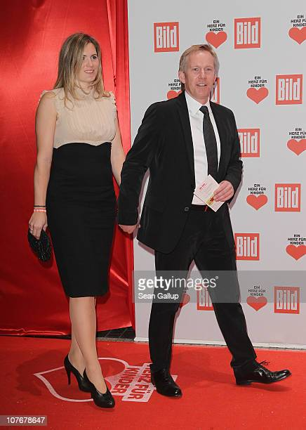 Television talk show host Johannes B Kerner and his wife Britta BeckerKerner attend the 'Ein Herz Fuer Kinder' charity gala at Axel Springer Haus on...