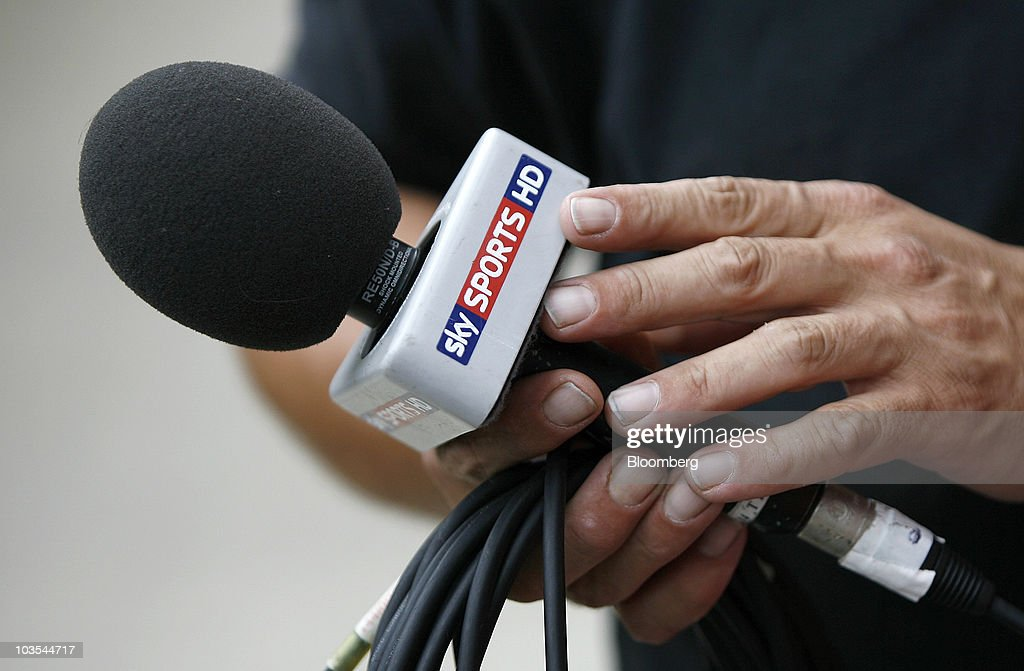 A television technician holds a branded Sky Sports HD microphone at Wigan Athletic Football Club in Wigan, U.K., on Saturday, Aug. 21, 2010. British Sky Broadcasting Group Plc, which rejected News Corp.'s proposed bid for full ownership last month, said annual adjusted operating profit rose 10 percent as more clients signed up for high-definition television service. Photographer: Simon Bellis/Bloomberg via Getty Images