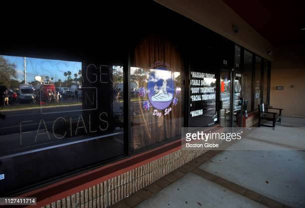 Television trucks are reflected in the windows of the Orchids of Asia Day Spa in Jupiter FL where New England Patriots owner Robert Kraft is alleged...