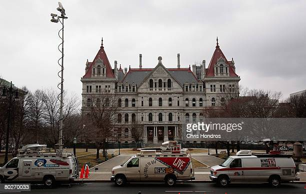 Television trucks line up outside the New York State Capitol March 16 2008 in Albany New York Lt Gov David Paterson will be sworn in here on March 17...