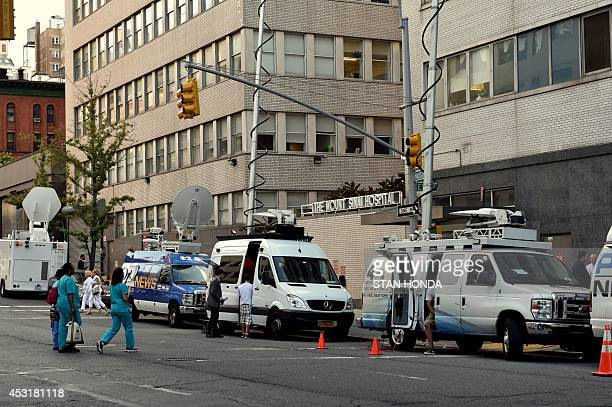 Television trucks on Madison Avenue outside Mount Sinai Hospital August 4 2014 in New York after officials announced a male patient who recently...