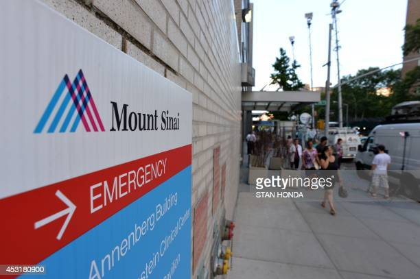 Television trucks on Madison Avenue outside the emergency room entrance to Mount Sinai Hospital August 4 2014 in New York after officials announced a...