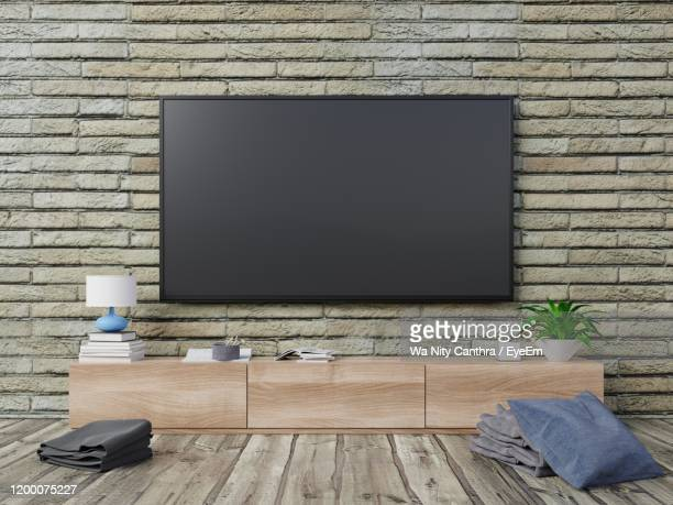 television unit at home - flat screen stock pictures, royalty-free photos & images