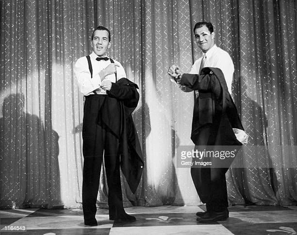 """Television variety show host Ed Sullivan and boxer Rocky Marciano remove their jackets on stage during Sullivan's variety show, """"Toast of the Town,""""..."""