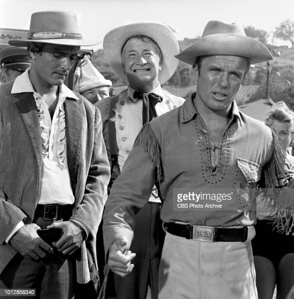 Television western Frontier Circus, episode, Mr. Grady Regrets, originally broadcast January 25, 1962. Pictured left to right, John Derek ; Chill...