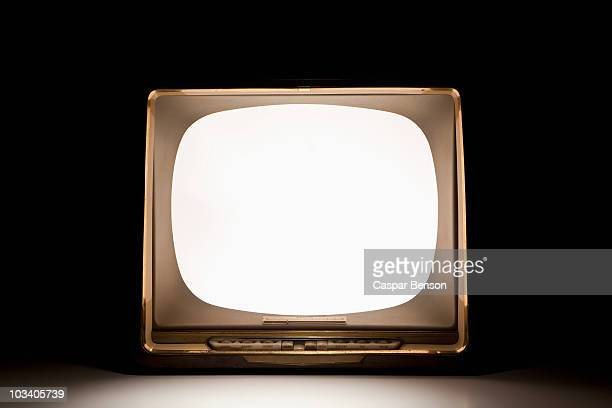 A television with an illuminated, blank screen