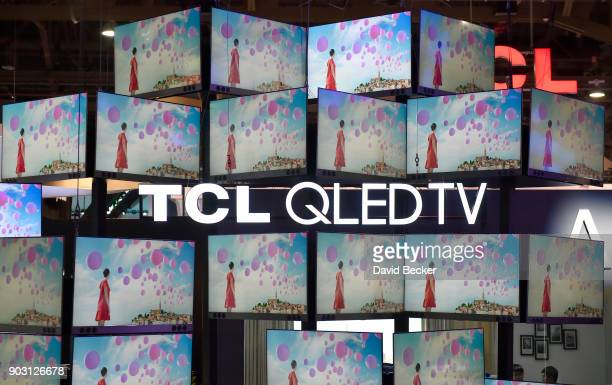 QLED televisions are displayed at the TCL booth during CES 2018 at the Las Vegas Convention Center on January 9 2018 in Las Vegas Nevada CES the...